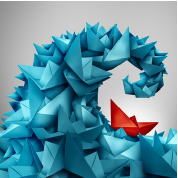 business risk trouble ahead as a group of paper boat